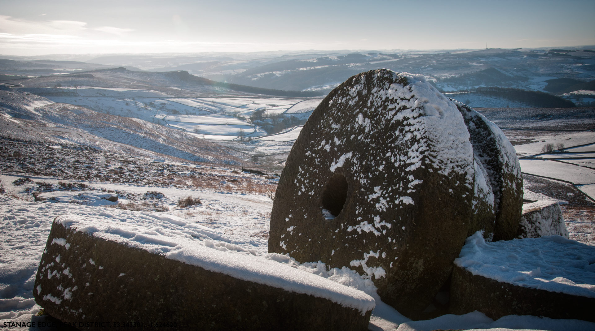 Stanage Edge Millstones in the snow of the Peak District near Sheffield